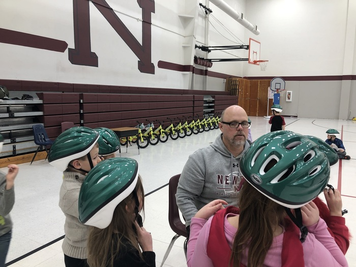 Mr. Wince teaching about helmets