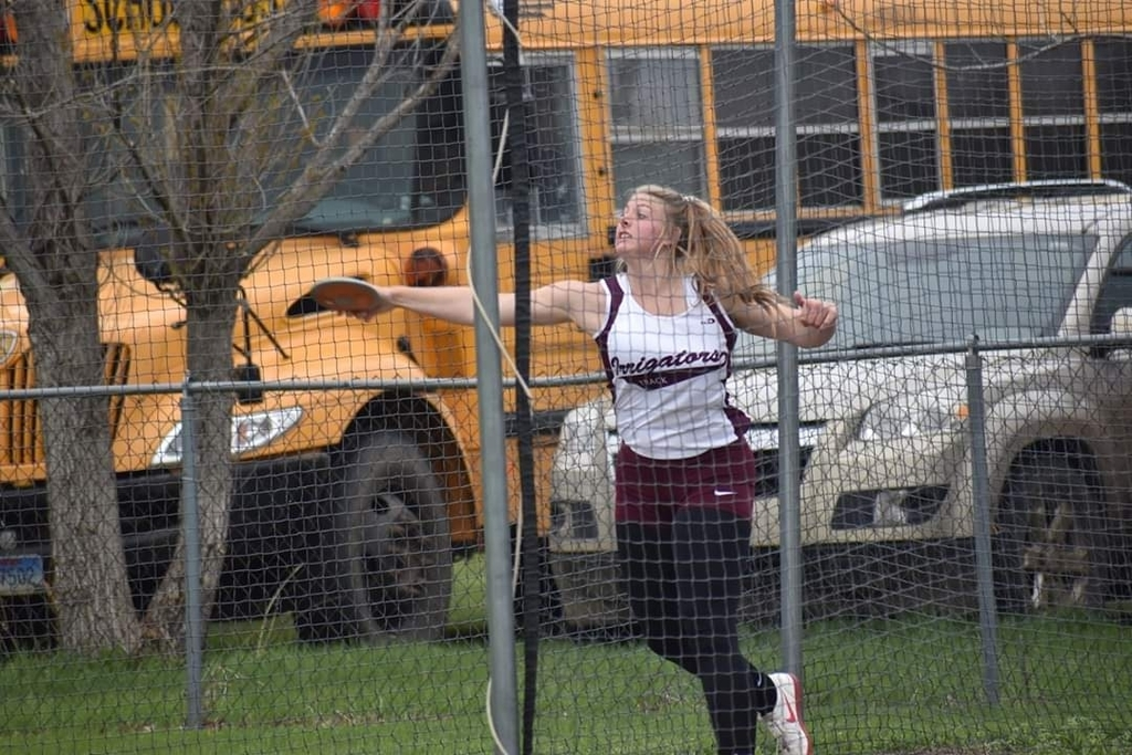 Dana Youngberg throwing the discus at the Region Track Meet where she placed 1st in the shot and discus.